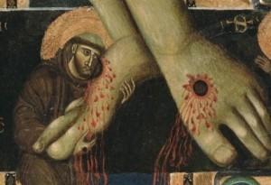 San Francesco abbraccia i piedi di Cristo
